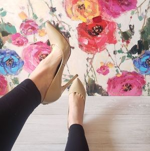 Nude Patent Leather PointyToe Pumps.